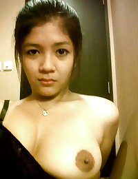 Hot asian  girl with a huge boobs
